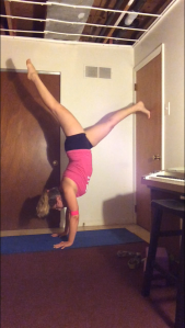 I am working on my fear of handstands (really the fear of face planting and breaking my face)